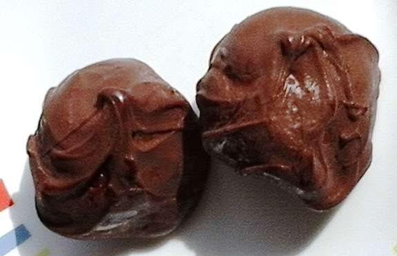 Kissing chocolate-covered candy