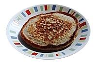 Oat-flour pancake on small platter